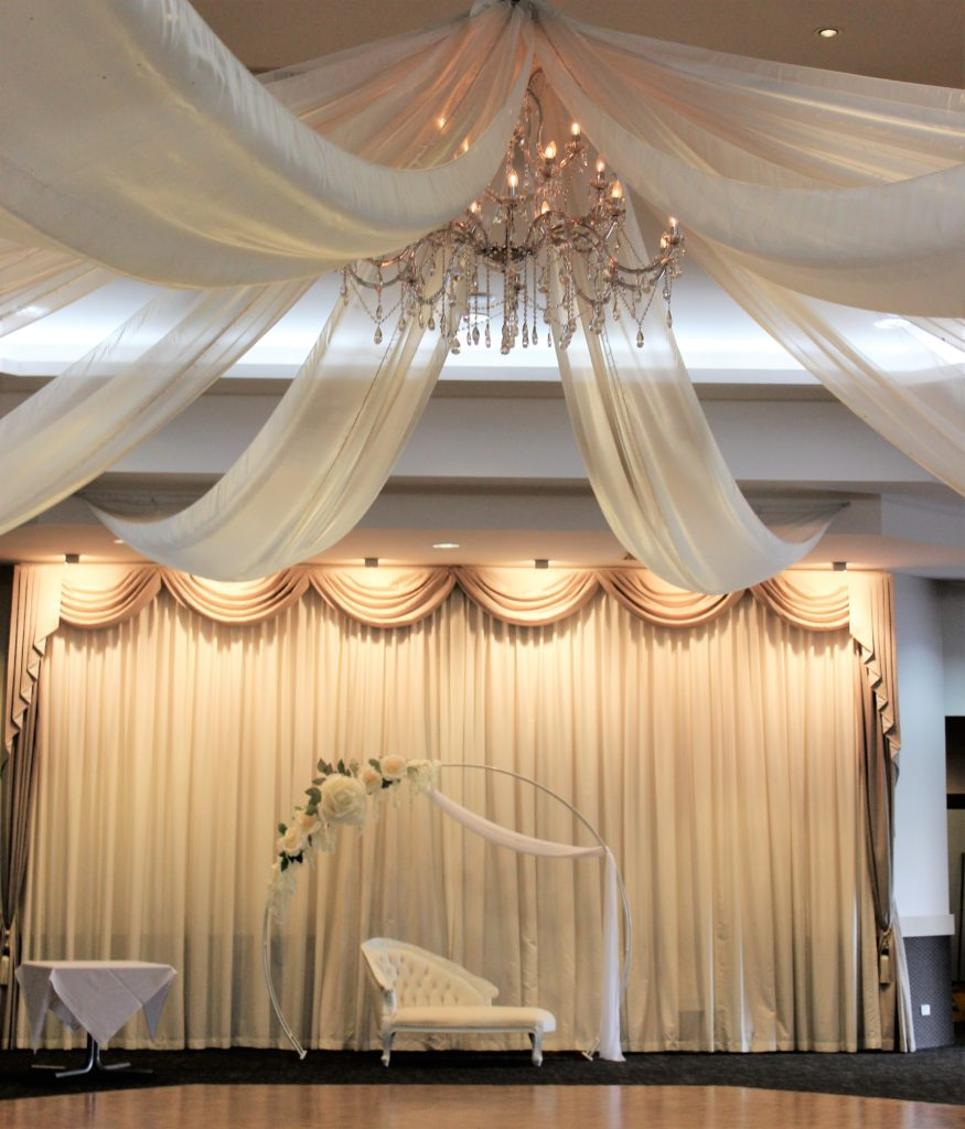 Arch Including Flowers and Draping